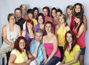 team of hairdressers with owners of business